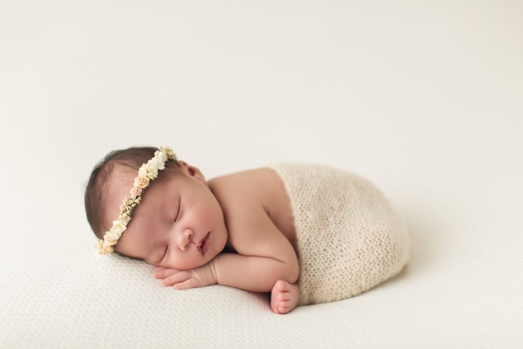 newborn baby photo in modified taco pose