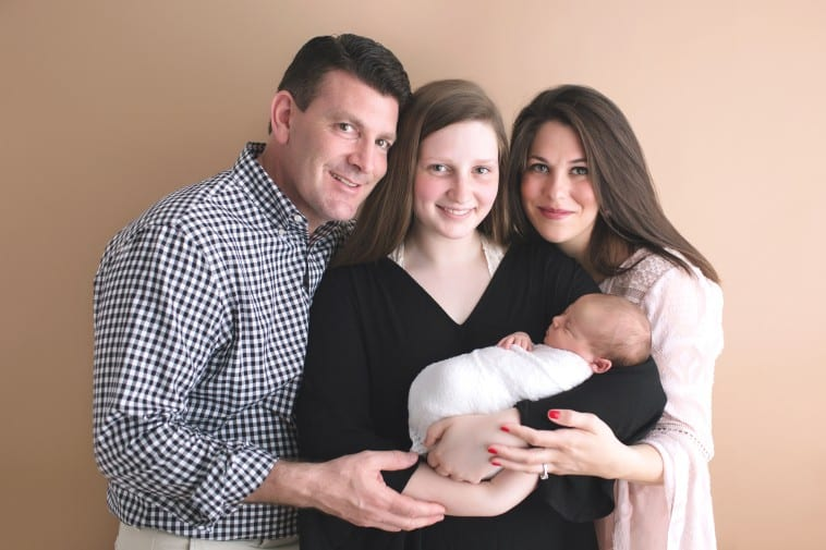 newborn baby photo with parents and sister