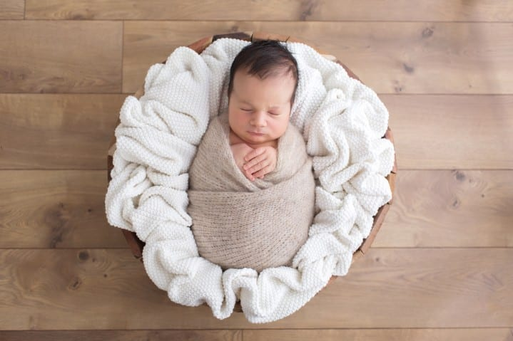 newborn baby photo fully swaddled in a prop