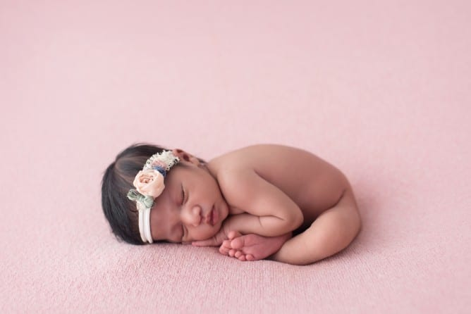 newborn baby photo in taco pose