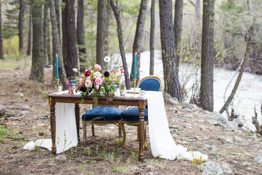 Vintage event rentals furniture at an outdoor wedding