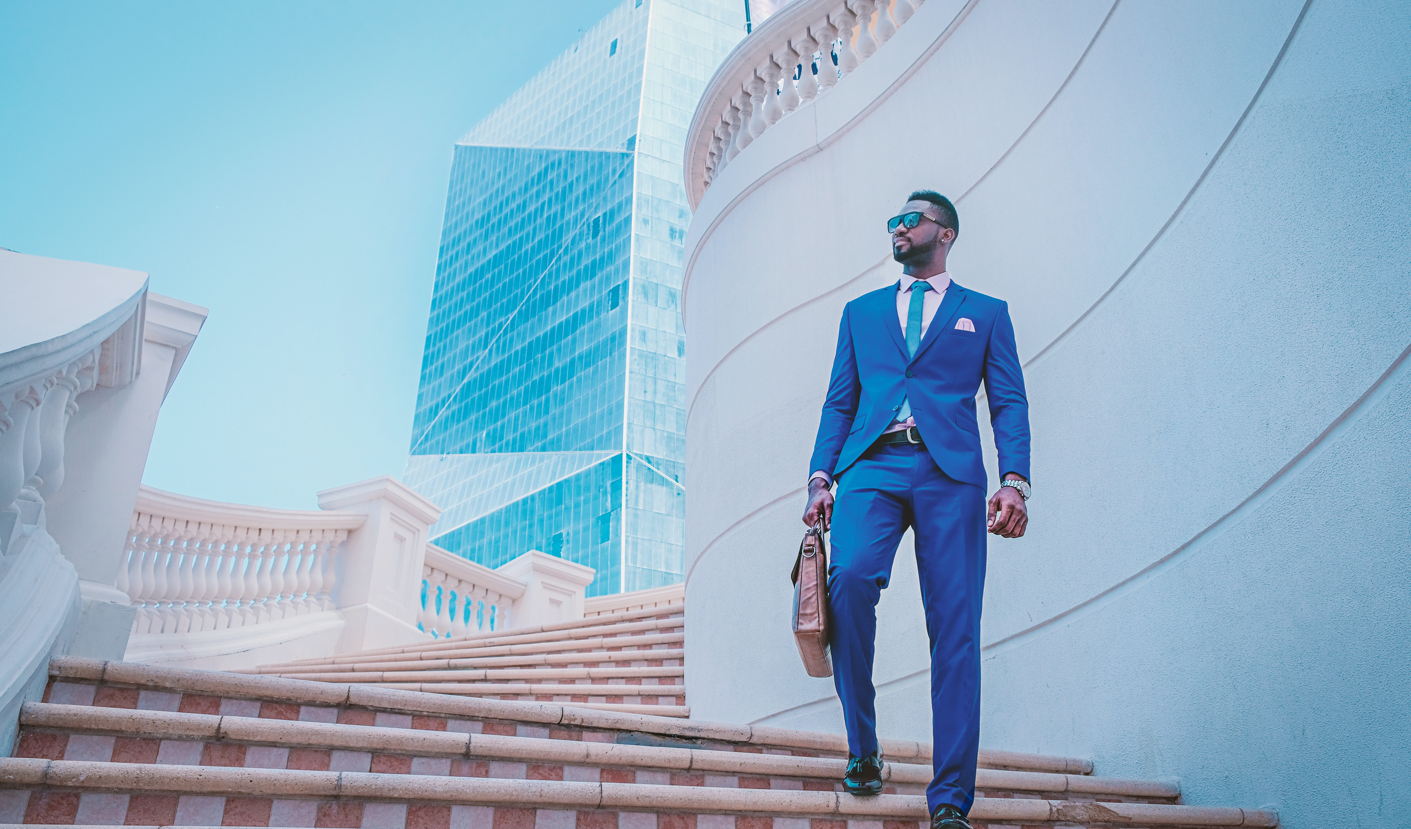 Man In Blue Suit and Briefcase Walking Down Stairs Gorilla Jobs Blog Tips To Building Strong Relationships with Recruiters