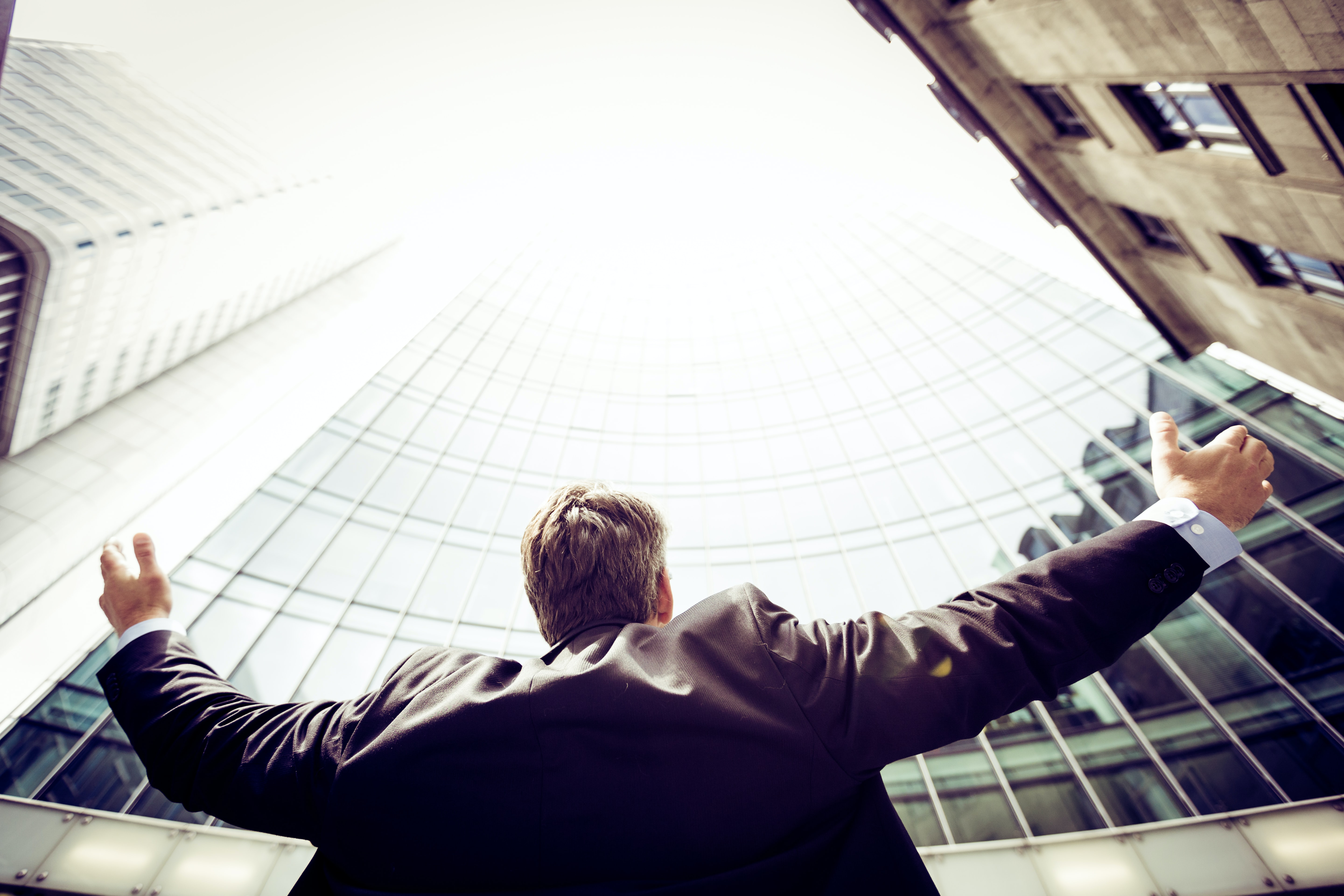 Gorilla Jobs Blog Reasons Why Lawyers Leave Firms Man Holding Arms Wide Open To The Sky