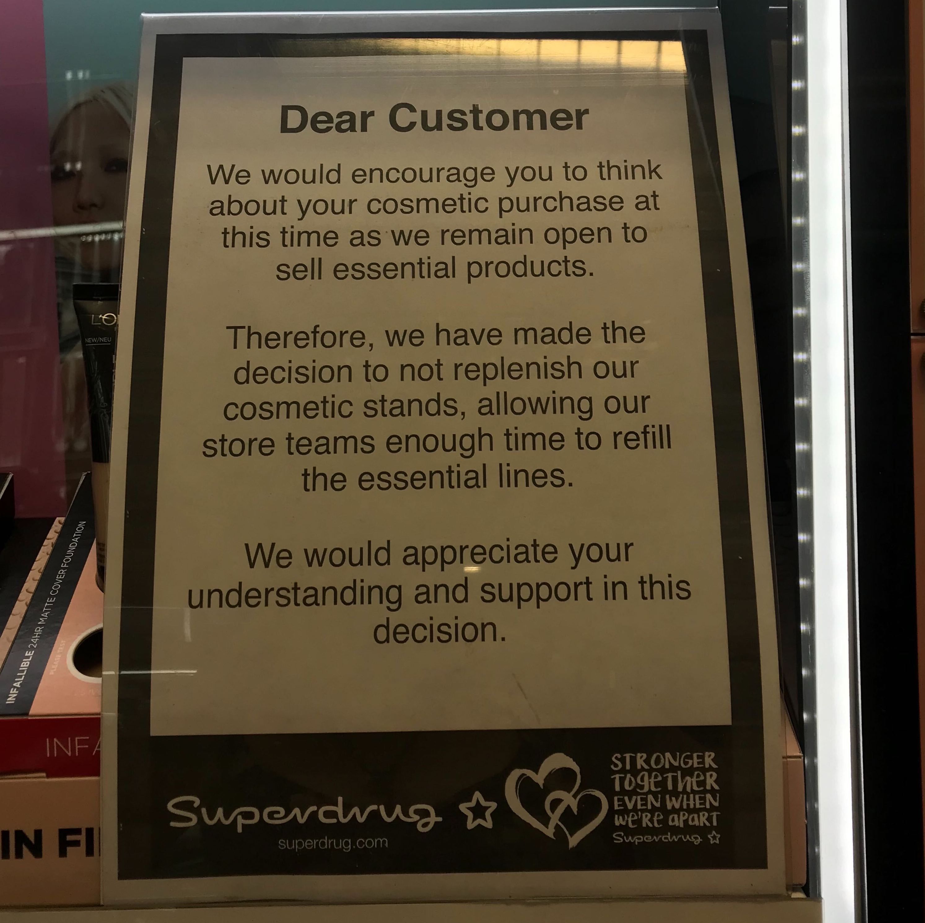 A notice in a store urging customers to think about their cosmetic purchases