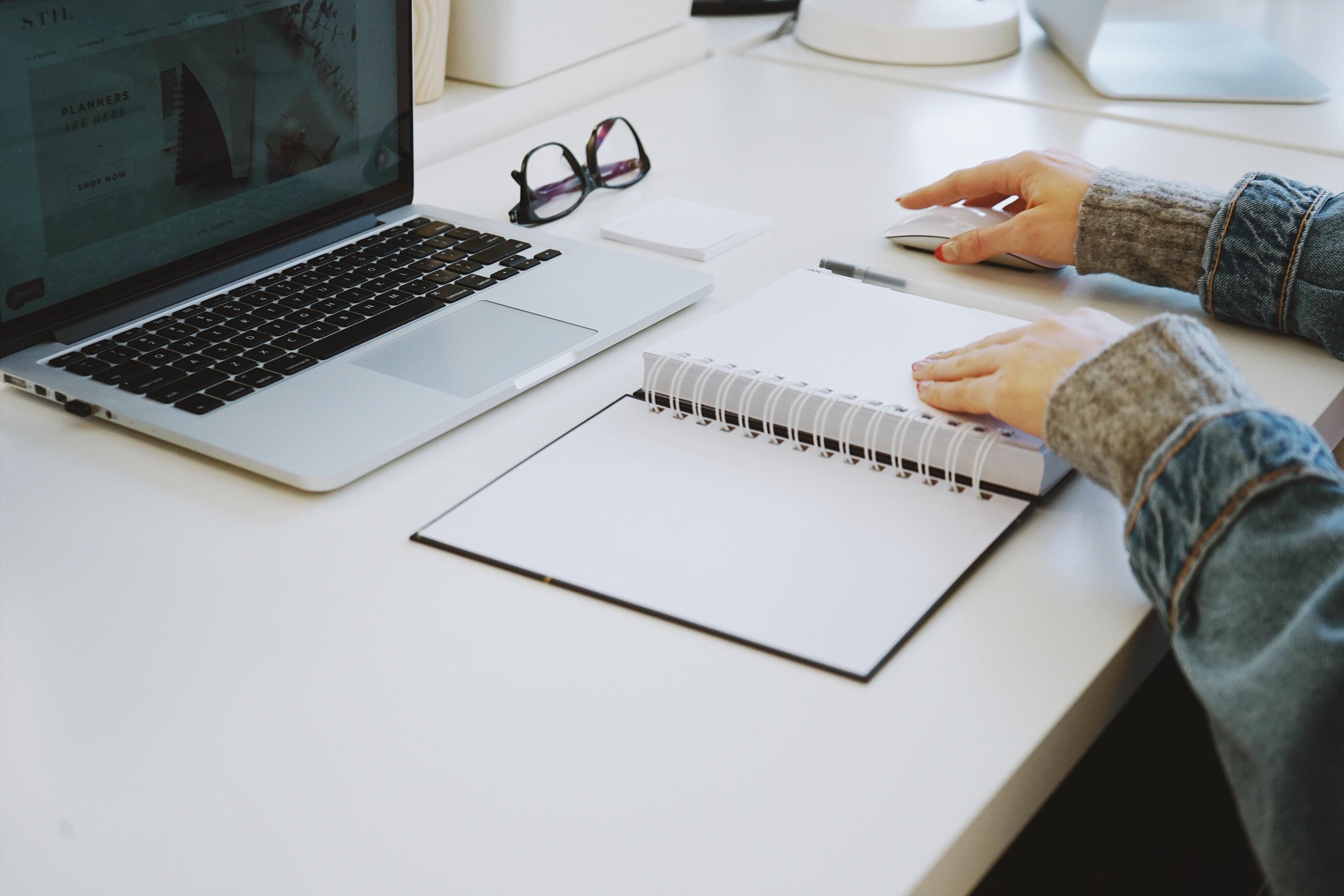 laptop and agenda on desk