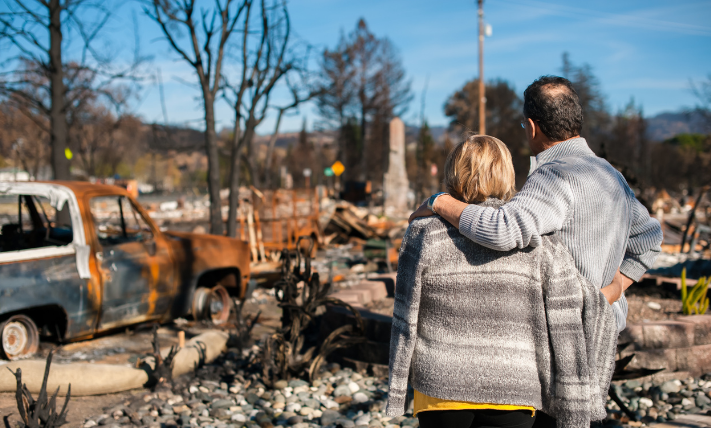 couple stands near burned home site