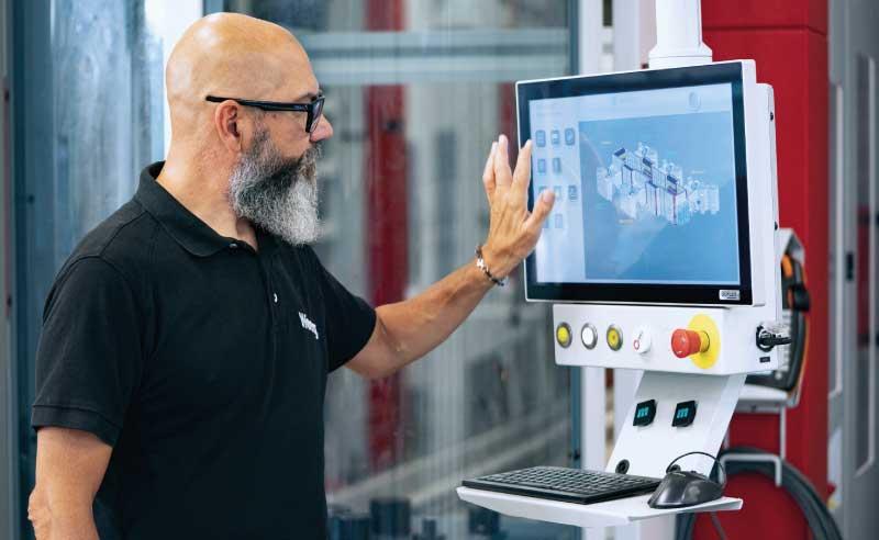 Man operating a CNC milling machine - cnc